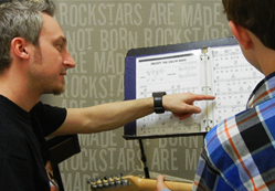 Jozef teaches guitar lessons